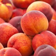 Heap of fresh organic peaches on display at a market.